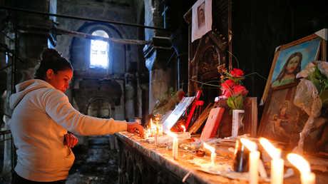 قداس في إحدى كنائس نينوى المدمرة