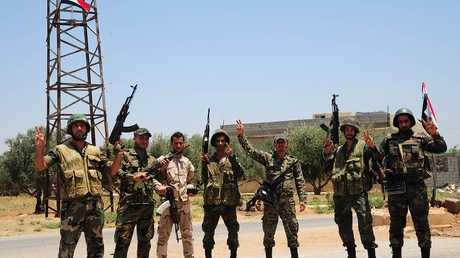 أفراد من الجيش السوري في درعا