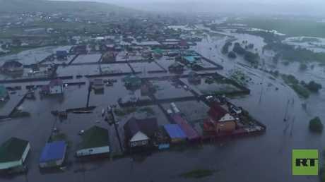 شاهد.. الفيضانات تجتاح مناطق في سيبيريا