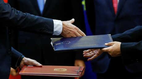بكين وبروكسل تتفقان على تعزيز التعاون التجاري والاستثماري بينهما