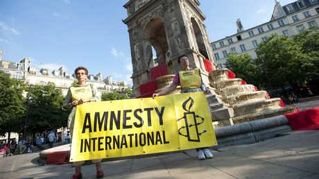 نشطاء لمنظمة العفو الدولية في باريس - صورة أرشيفية
