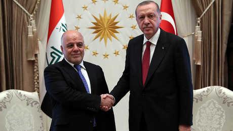 الرئيس التركي، رجب طيب أردوغان، ورئيس الوزراء العراقي، حيدر العبادي
