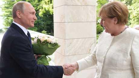 الرئيس الروسي والمستشارة الألمانية