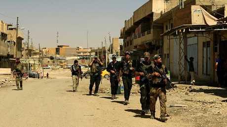 القوات العراقية في الموصل بعد تحريرها من داعش - أرشيف