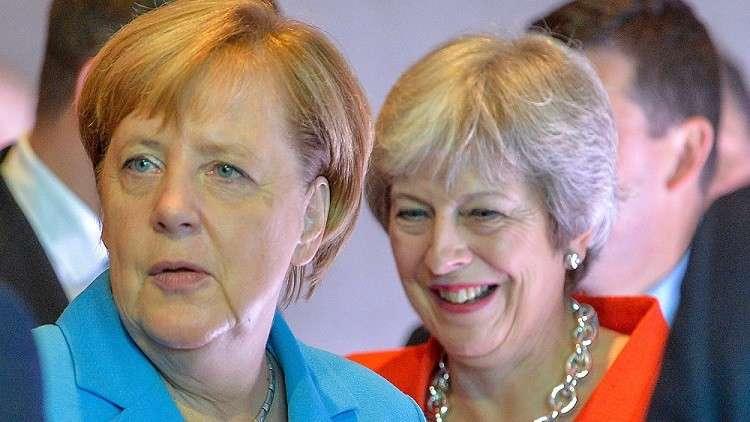 ميركل تشيح بوجهها عن ماي وتتجاهلها خلال القمة الأوروبية