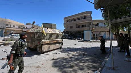 """عناصر لـ""""وحدات حماية الشعب"""" الكردية في شوارع القامشلي"""