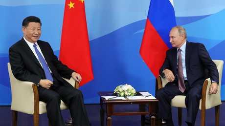 الرئيس الروسي، فلاديمير بوتين، للرئيس الصيني، شي جين بينغ