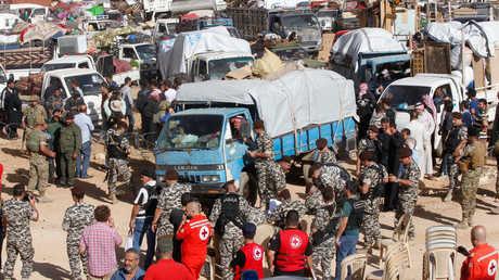 لاجئون سوريون يعودون إلى وطنهم من لبنان