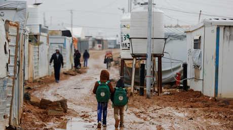 لاجئون سوريون في مخيم الزعتري