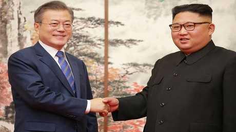 قائدا الكوريتين الجنوبية والشمالية مون جيه إن، وكيم جون أون