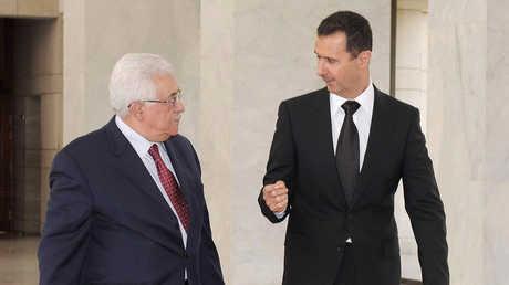 الأسد وعباس في لقاء سابق