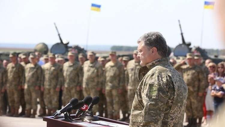 بوروشينكو يهدد روسيا مستقويا بالناتو