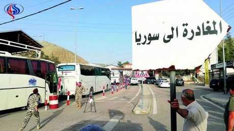 قافلة تقل لاجئين سوريين من لبنان إل ديارهم