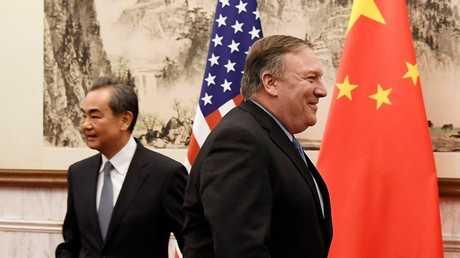 وزير الخارجية الأمريكى مايك بومبيو ونظيره الصيني وانغ يى - بكين
