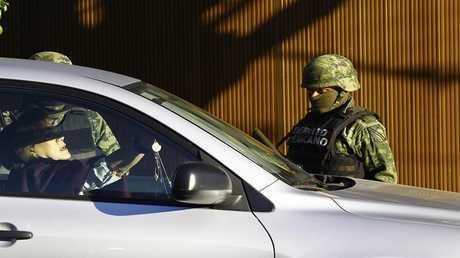 اعتقال نجل زعيم عصابة