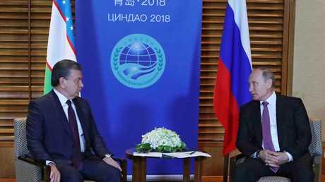 لقاء الرئيسين الروسي فلاديمير بوتين والأوزبكي شوكت مرضيايف على هامش قمة منظمة شنغهاي للتعاون في مدينة تشينغداو الصينية، 9 يونيو 2018