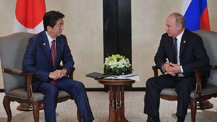 آبي يعد بوتين بعدم نشر قواعد أمريكية في جزيرتين من جزر الكوريل قد تعيدهما روسيا لليابان