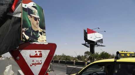 أرشيف - طريق المزة السريع في دمشق في 12 مايو 2014