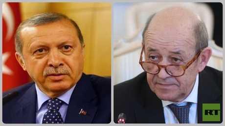 الرئيس التركي رجب طيب أردوغان ووزير الخارجية الفرنسي جان إيف لودريان