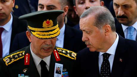 خلوصي أكار والرئيس التركي رجب طيب أردوغان - صورة أرشيفية