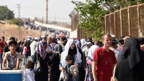 لاجئون سوريون يتوجهون إلى وطنهم من تركيا في عيد الأضحى يوم 28 أغسطس 2017