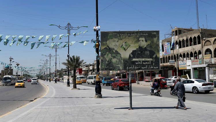سياسي عراقي يطالب بطرد السفير الإيراني لدى بغداد