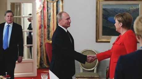 بوتين وميركل على هامش قمة G20 في بوينس آيرس، 1 ديسمبر 2018