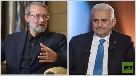 رئيس البرلمان التركي بن علي يلديريم ورئيس مجلس الشورى الإيراني علي لاريجاني
