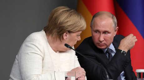 الرئيس الروسي، فلاديمير بوتين مع المستشارة الألمانية، أنغيلا ميركل