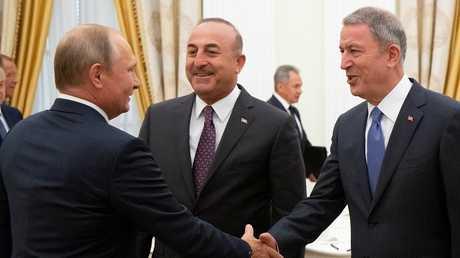 أرشيف - بوتين يستقبل وزيري الخارجية والدفاع التركيين في الكرملين، 24 أغسطس 2018