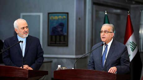 وزير الخارجية العراقي،محمد علي الحكيم، ونظيره الإيراني، محمد جواد ظريف (بغداد، 13 يناير 2019)