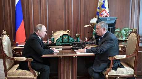الرئيس الروسي فلاديمير بوتين ورئيس شركة