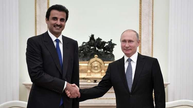 أرشيف - بوتين وأمير قطر تميم بن حمد آل ثاني، 15 يوليو 2018