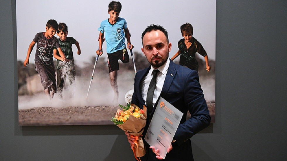 الفتى العراقي بطل صورة