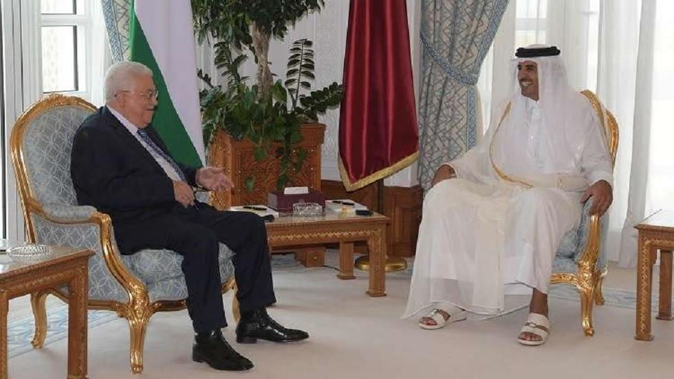 الرئيس الفلسطيني محمود عباس وأمير قطر الشيخ تميم بن حمد بن خليفة آل ثاني