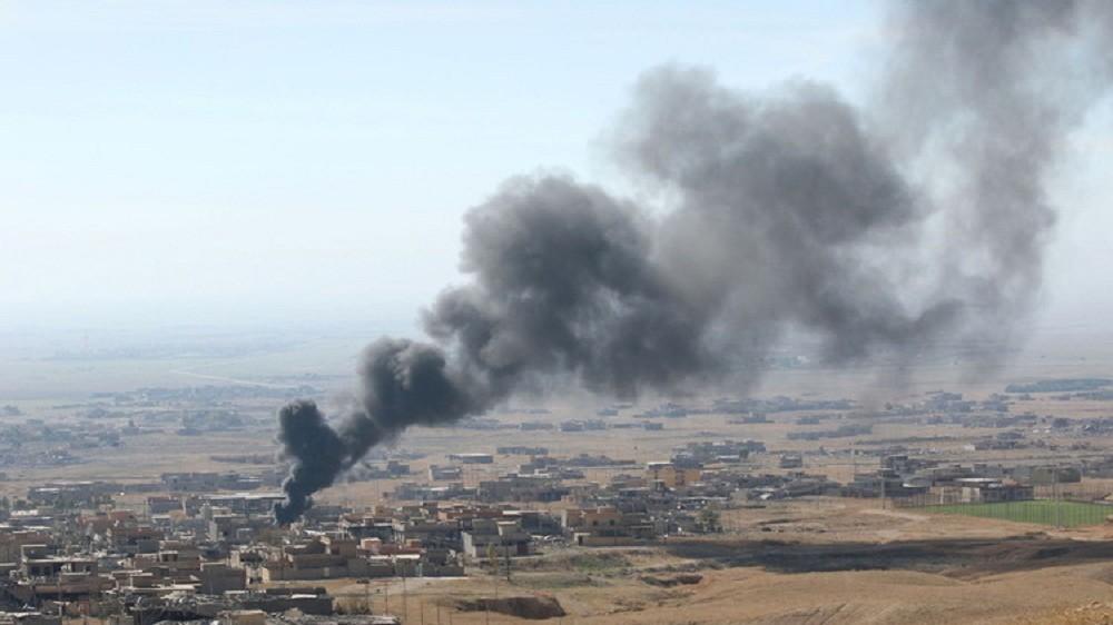 بالصور.. قتلى وجرحى بتفجير سيارة مفخخة في بلدة عراقية قرب الحدود السورية
