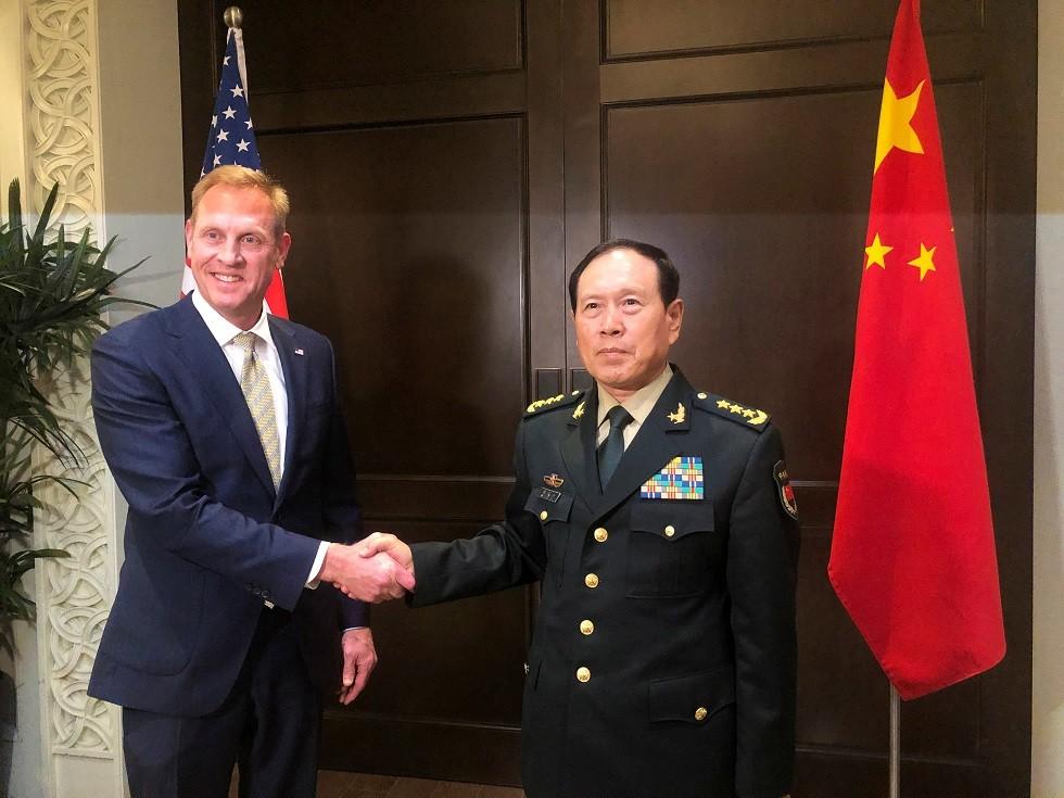 وزير الدفاع الصيني وي فنغ خه والقائم بأعمال وزير الدفاع الأمريكي باتريك شاناهان