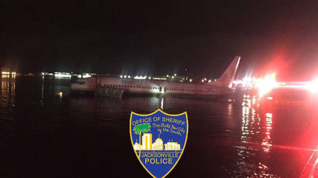 US passenger jet skips off runway and falls in river, Florida