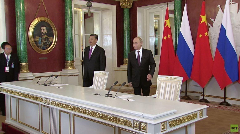 اتفاق روسي صيني على حل الأزمات الدولية