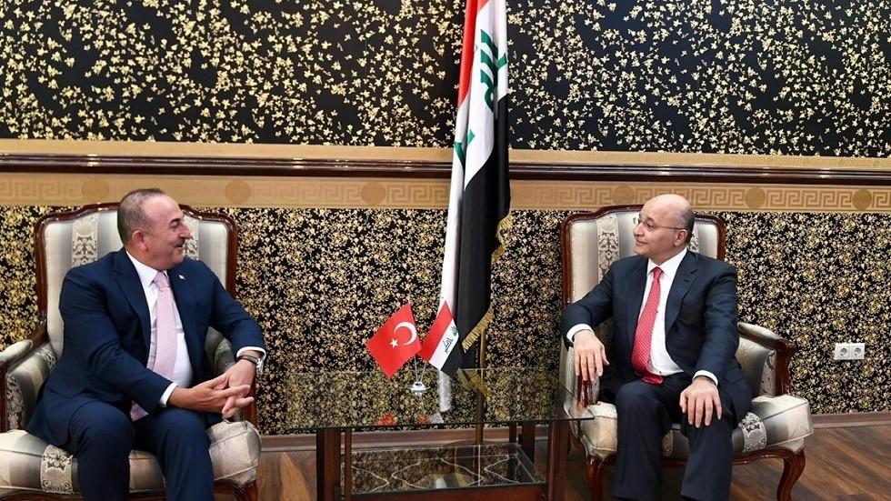 الرئيس العراقي برهم صالح ووزير خارجية تركيا مولود تشاووش أوغلو