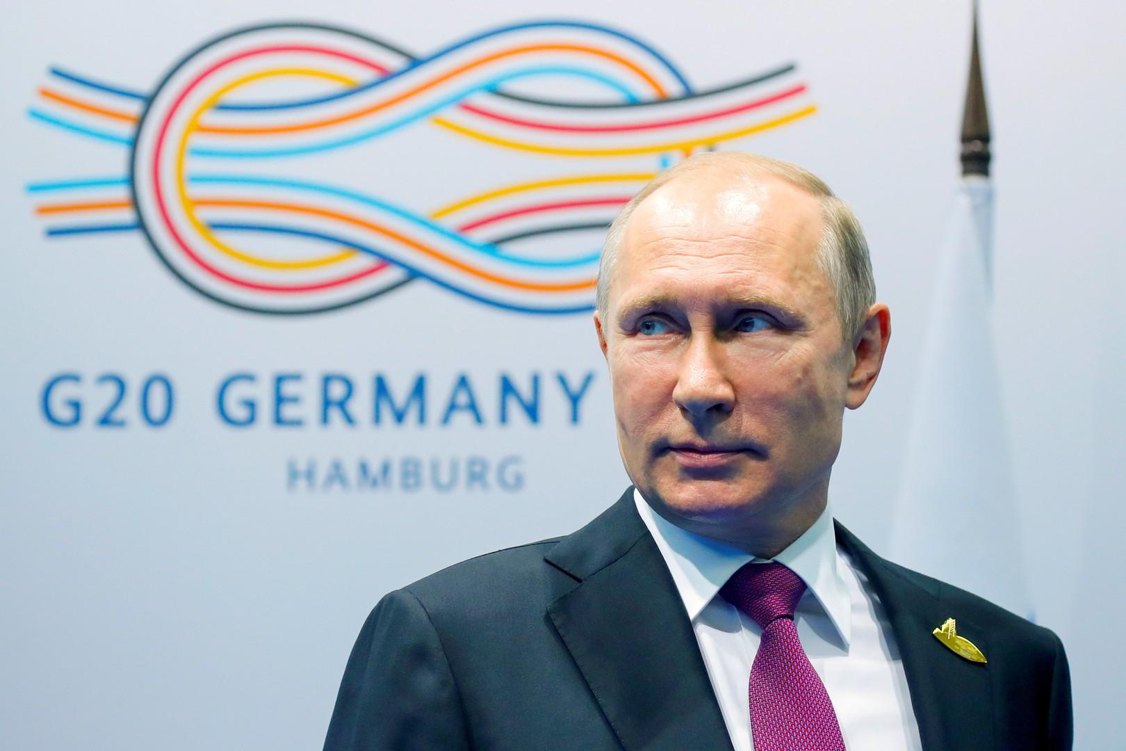 """أرشيف - الرئيس الروسي فلاديمير بوتين خلال قمة """"العشرين"""" في ألمانيا"""