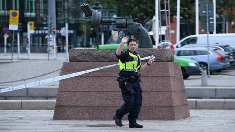 police shoot man who threatened to blow up a train station in sweden