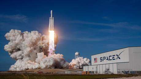 SpaceX launched a super-heavy Falcon rocket with as many as 150 people aboard