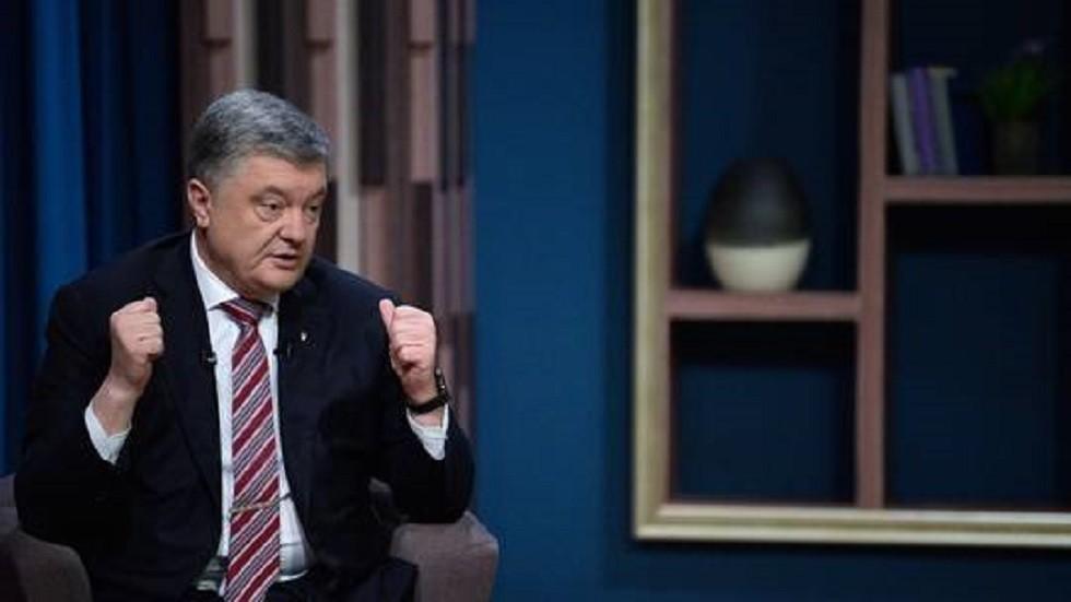 بوروشينكو يثير الشبهة بسحب 340 كغ من الدولارات