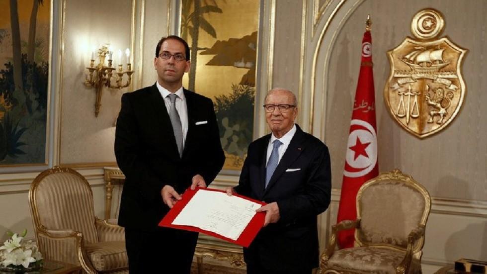 الرئيس التونسي الراحل الباجي قائد السبسي ورئيس الوزراء يوسف الشاهد