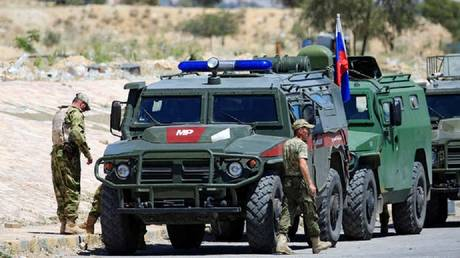 Russia announces attack on militants targeting its military police south of Syria and no injuries