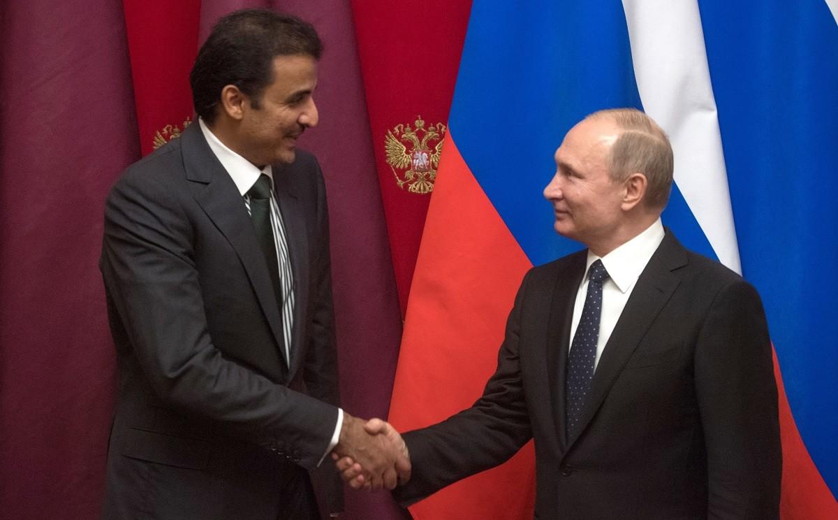 الرئيس الروسي فلاديمير بوتين وأمير قطر تميم بن حمد آل ثاني (صورة أرشيفية)