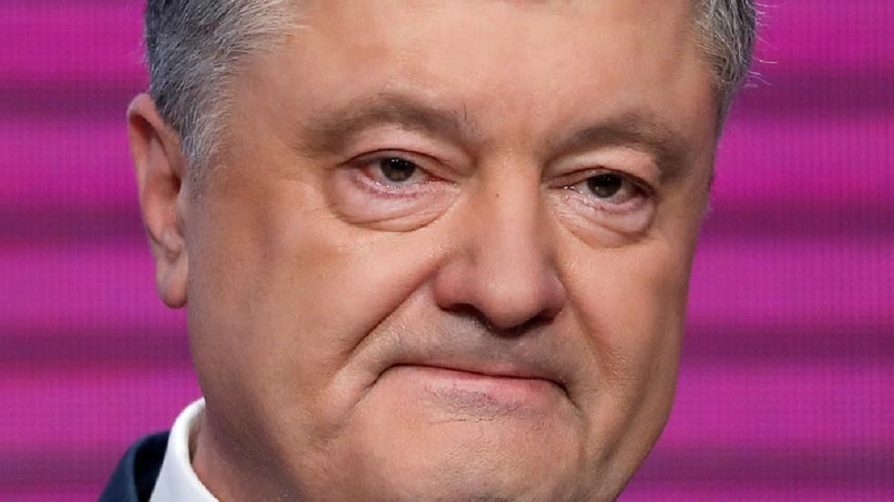 ملياردير أمريكي يتهم بوروشينكو بسرقة مليارات الدولارات
