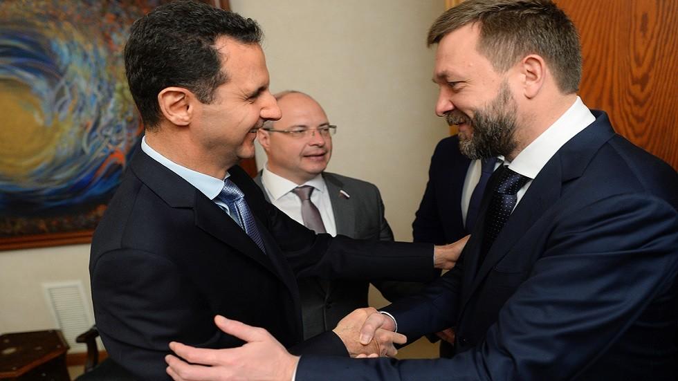 النائب الروسي دميتري سابلين والرئيس السوري بشار الأسد أثناء زيارة وفد برلماني روسي إلى دمشق في أبريل 2016