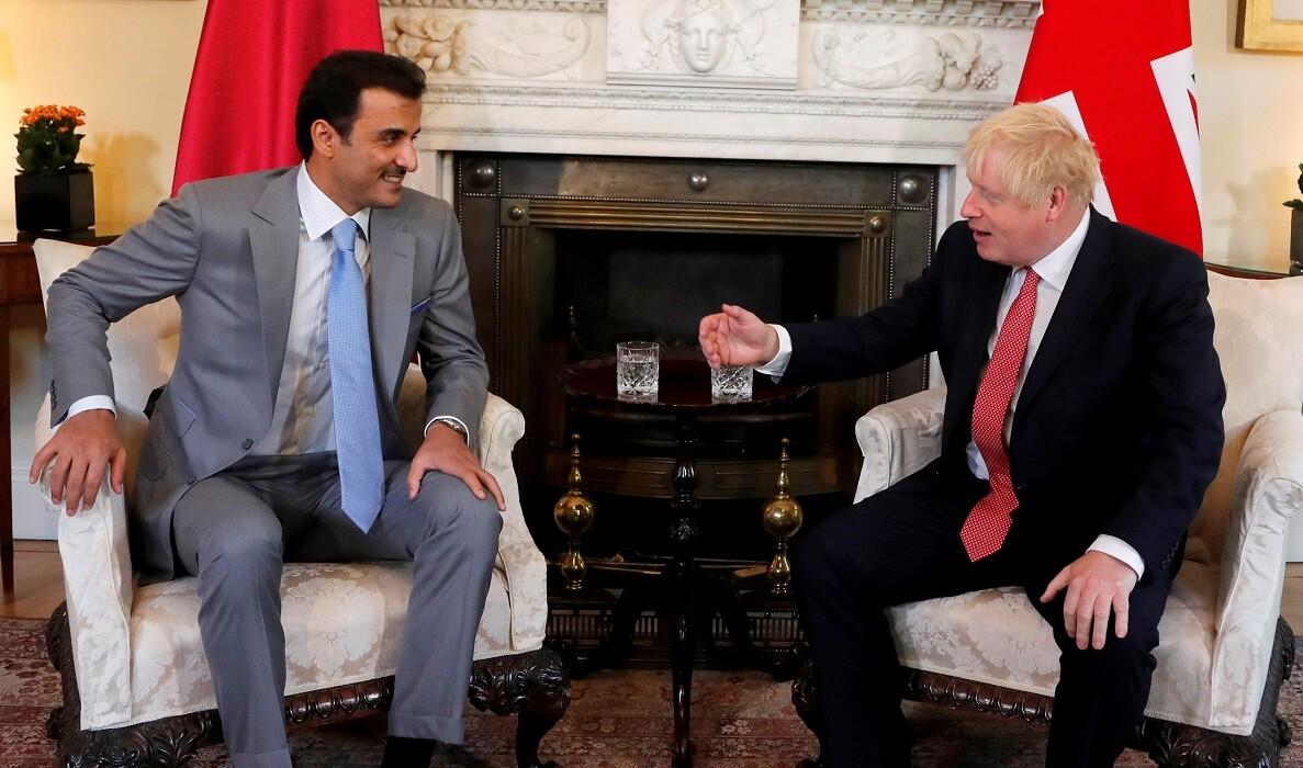 رئيس الوزراء البريطاني، بوريس جونسون، وأمير قطر، الشيخ تميم بن حمد آل ثاني
